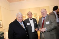 Elmira College President Thomas K. Meier, Historic Elmira Chairman George L. Howell, and Historic Elmira Treasurer Donald G. Quick converse at the awards reception.