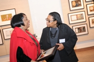 Accepting the Project Award on behalf of the John W. Jones Museum, Board President Lucy Brown (left) talks with fellow Board member Talima Aaron.